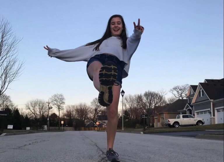 Teenager skipping on street