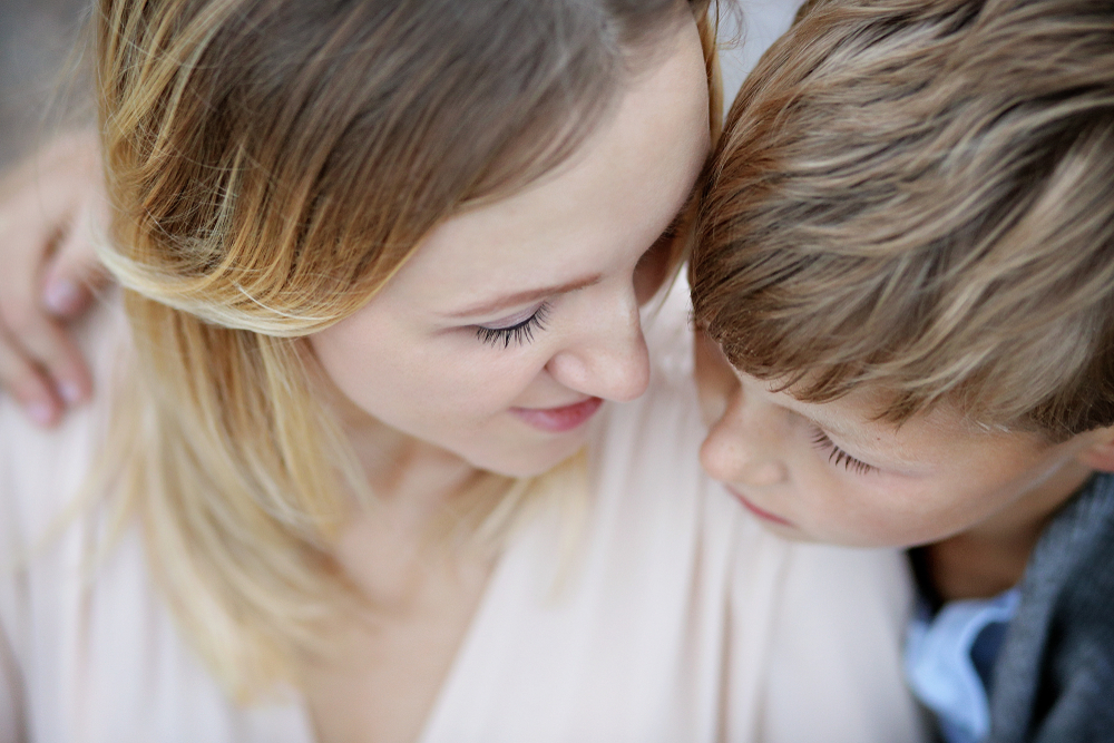 Mother and son touch foreheads