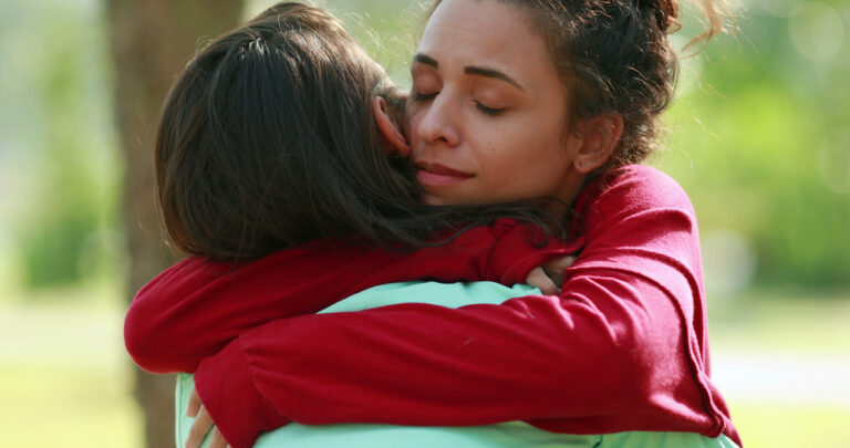 Woman hugging a friend