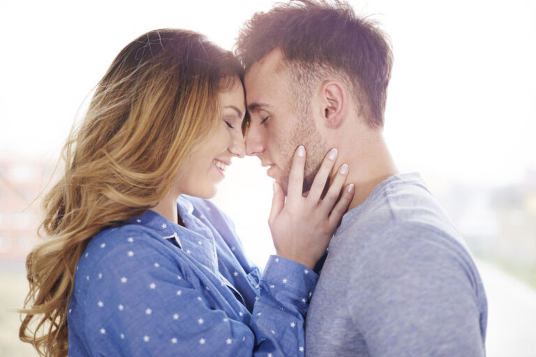 husband and wife touch foreheads