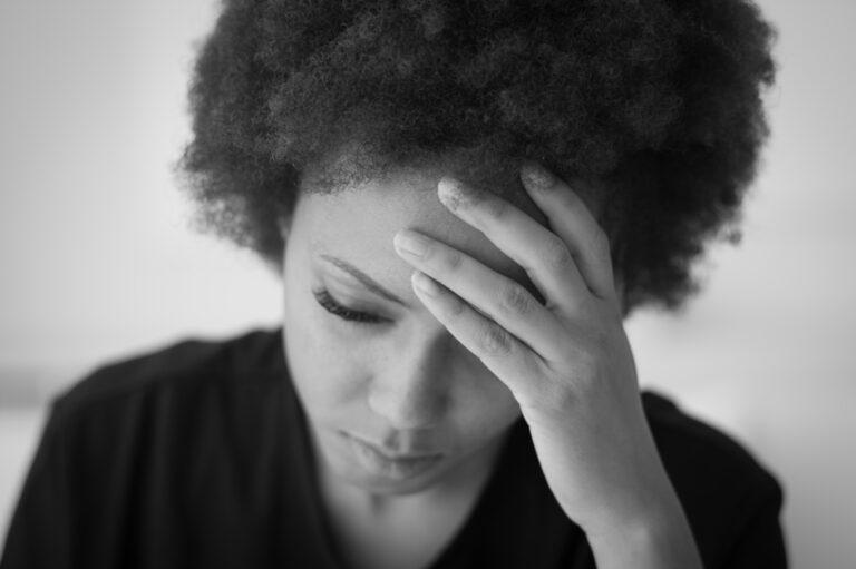 Sad woman head in hands