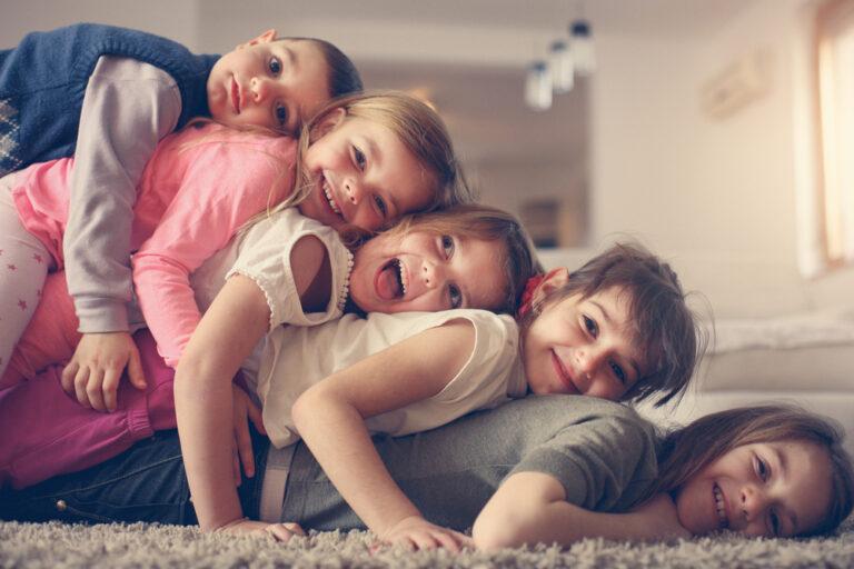 Five siblings in living room