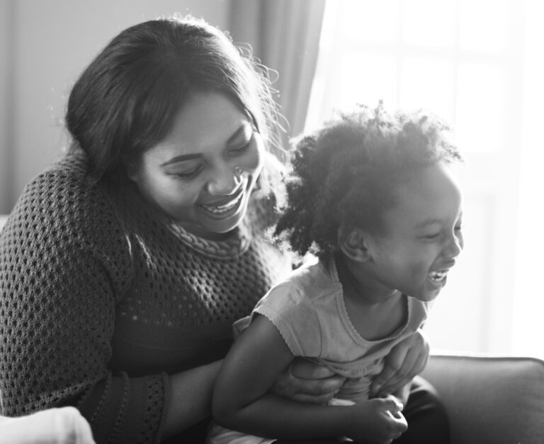 Mom with toddler laughing