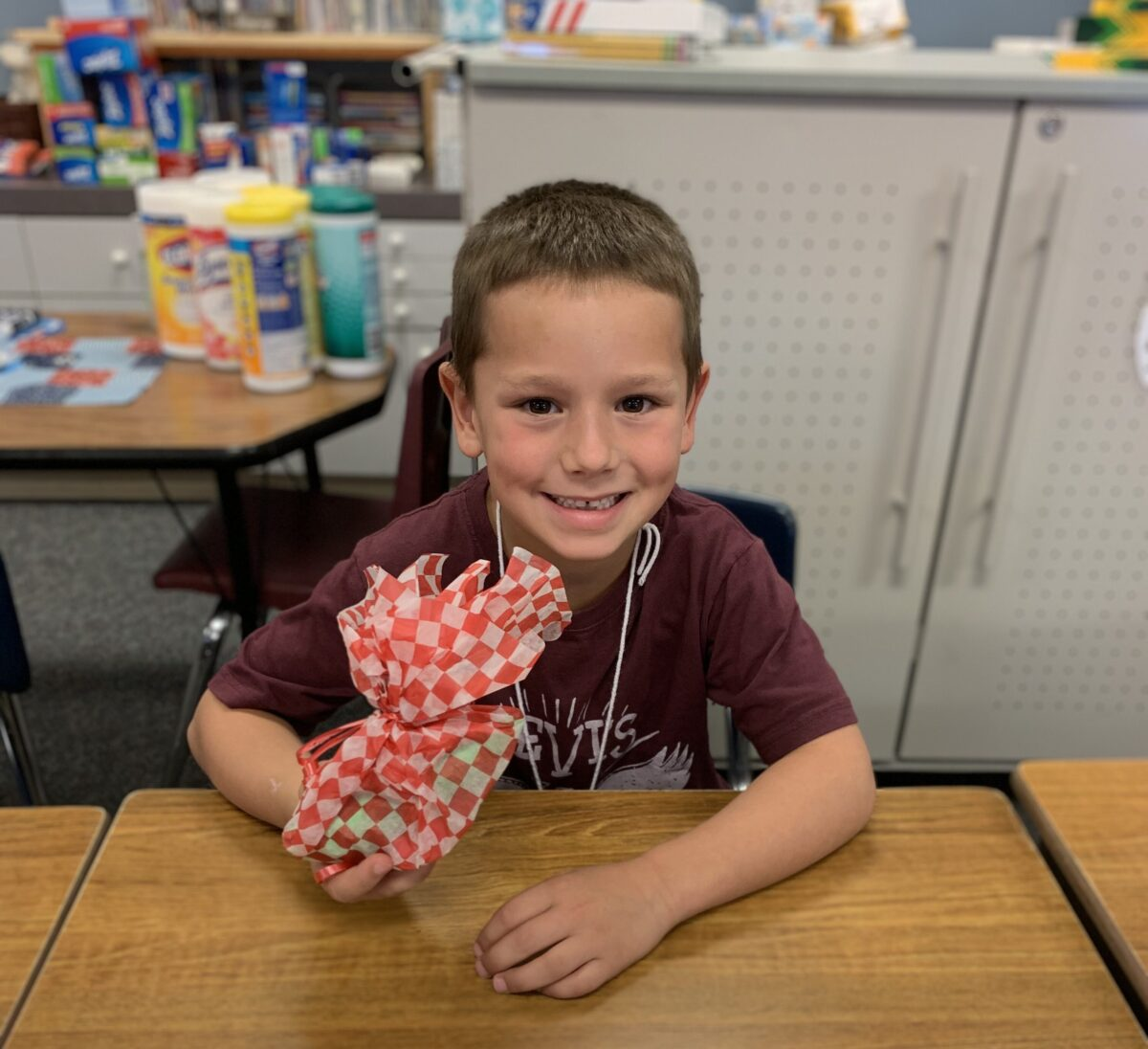 Little boy at desk in school classroom
