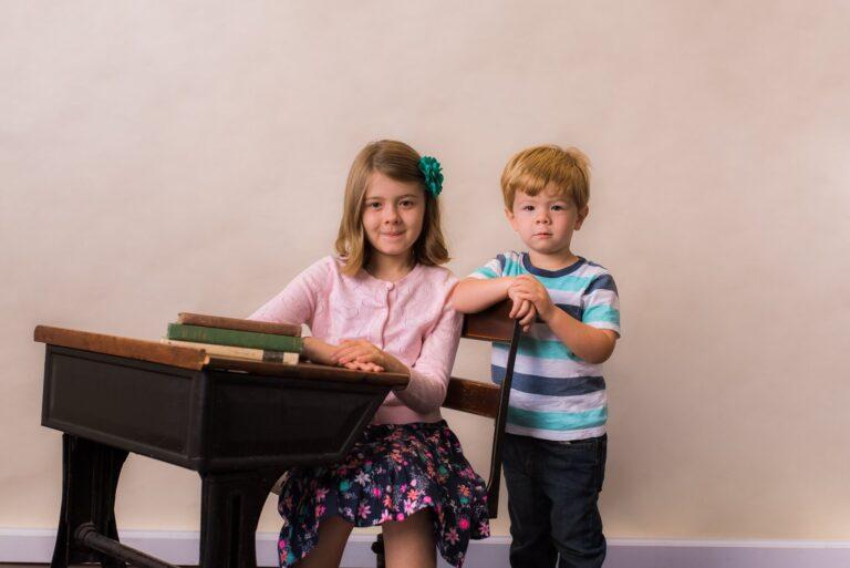 Two kids at school desk