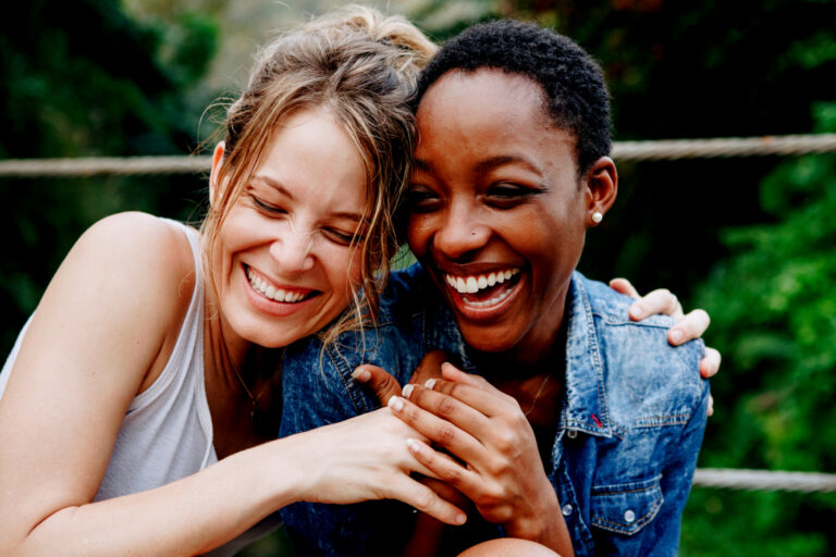 Two friends laughing