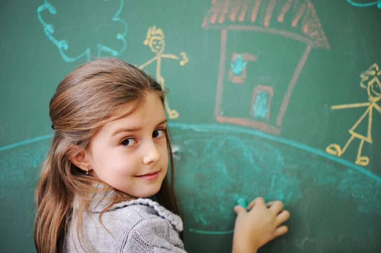 Young student at chalkboard