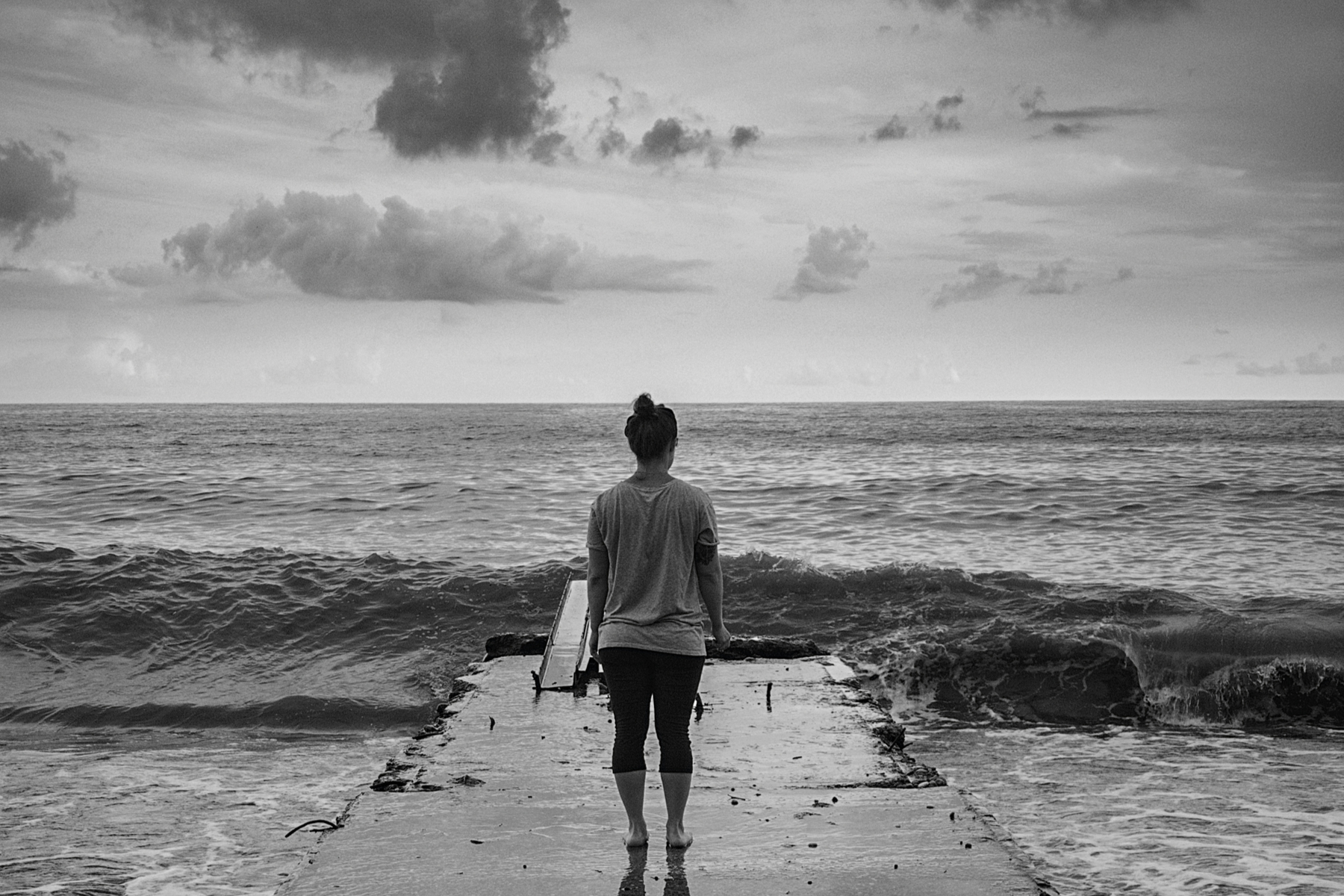 Woman alone by water