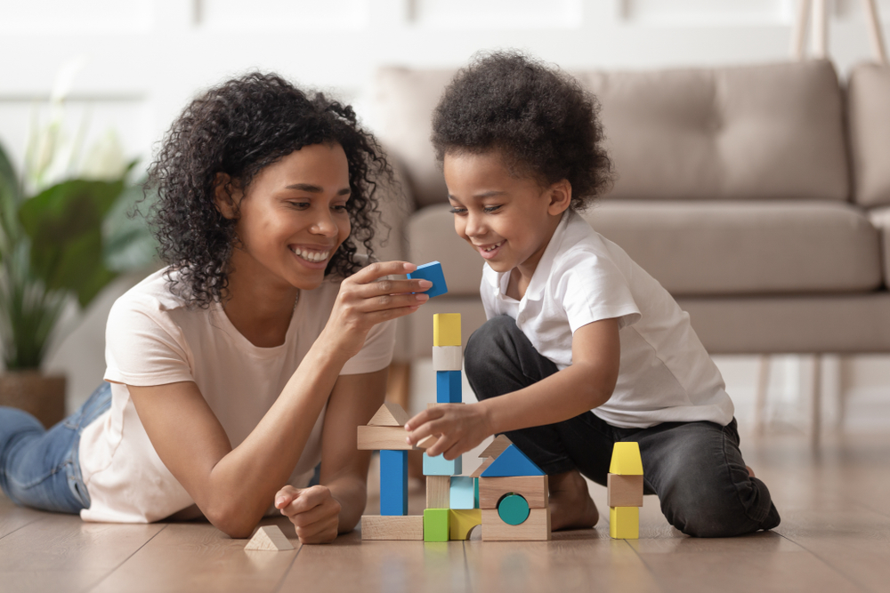 Preschool child and mom playing blocks