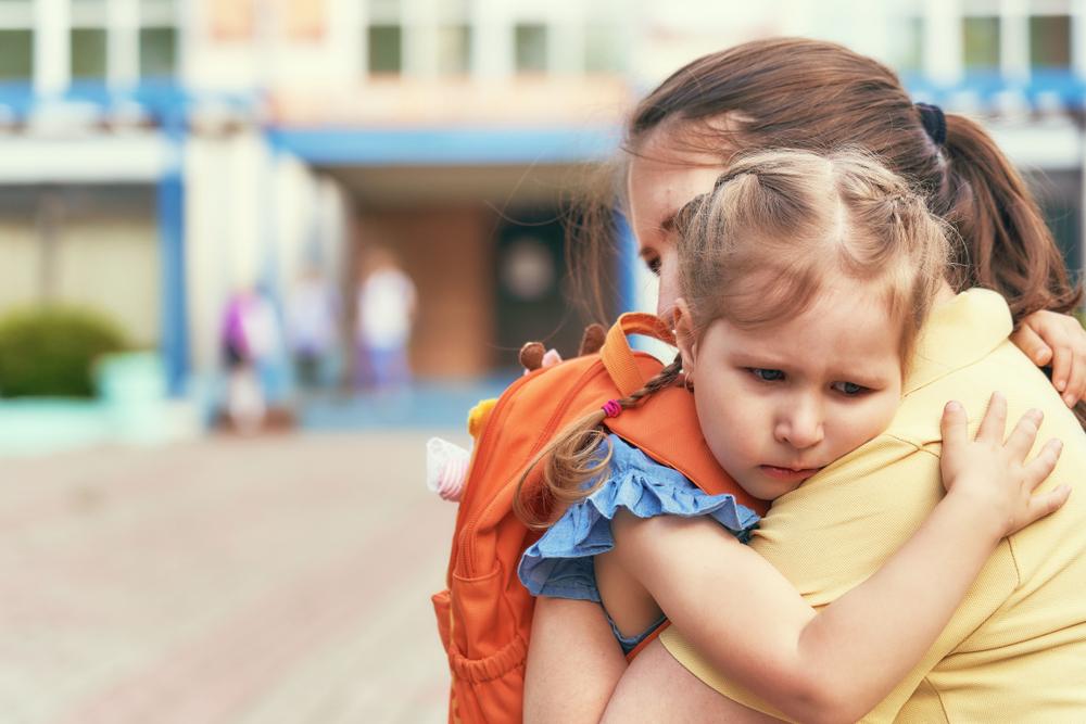Mom hugging kindergarten student