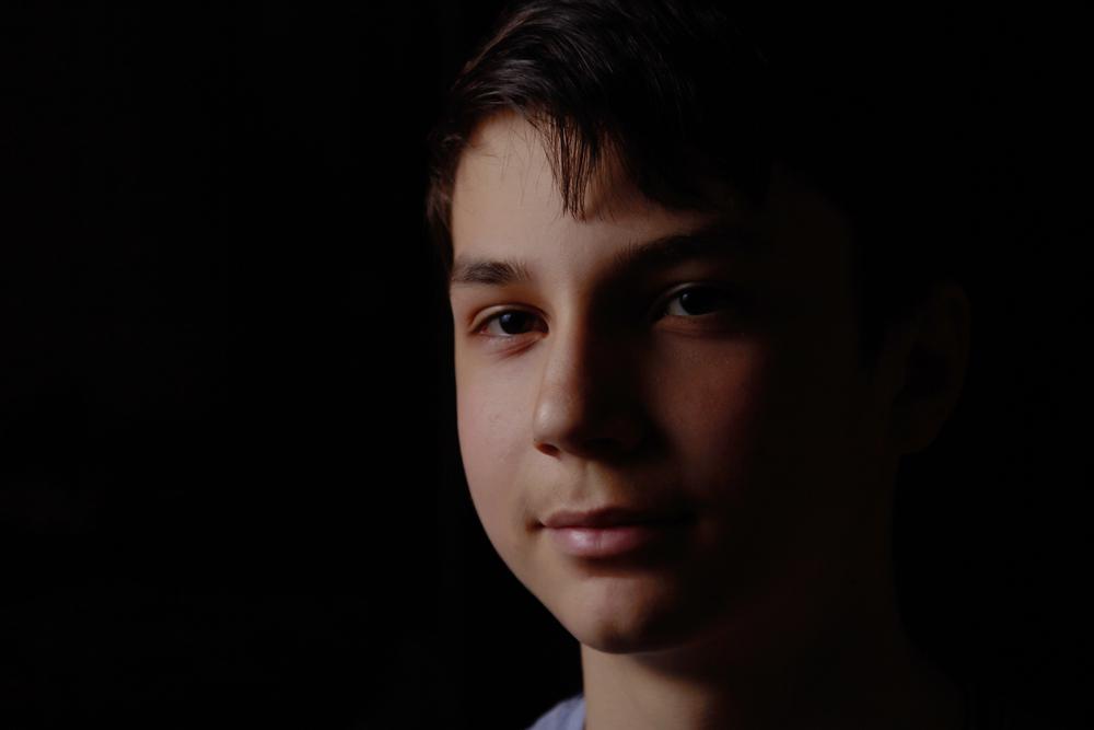 Teen smiling in dark