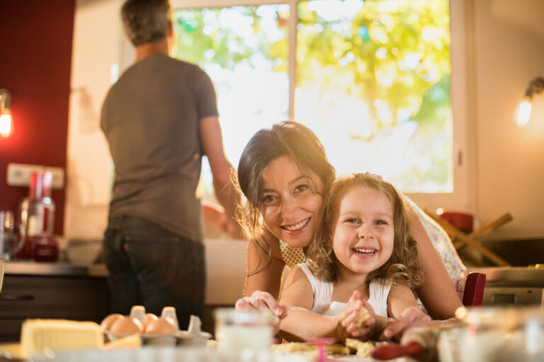 Mom baking with daughter at home