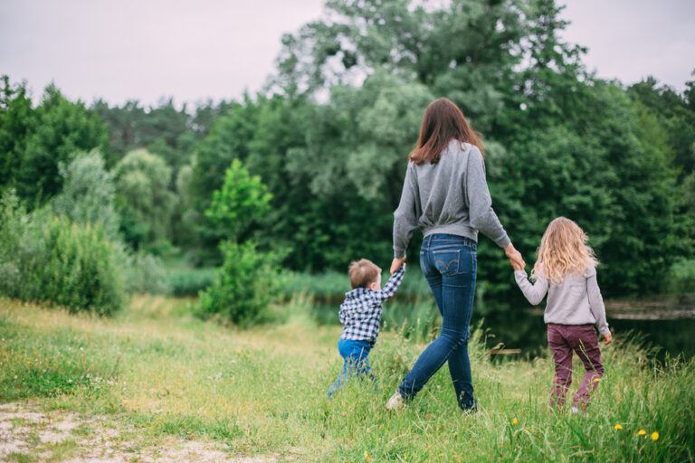 Mom with two kids walking