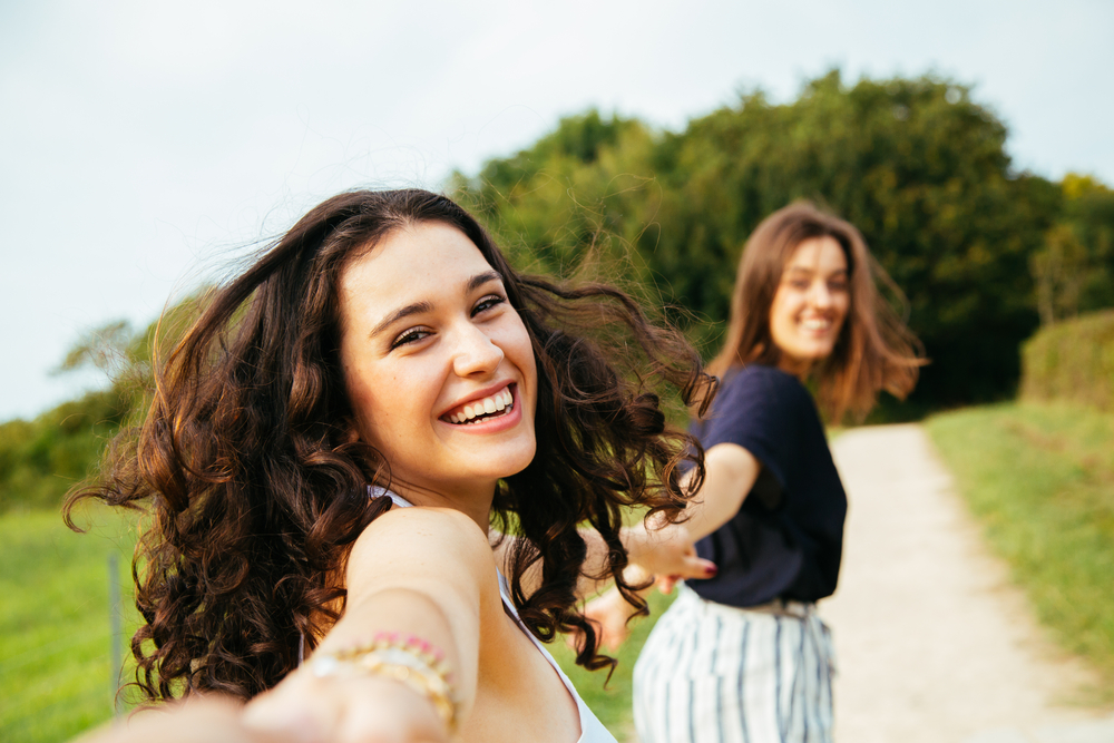 Two girls smiling in sun