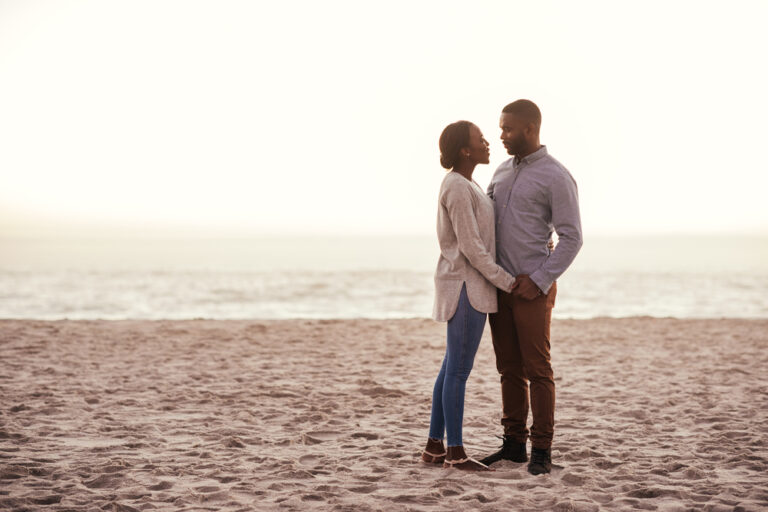 Man and woman standing on beach together