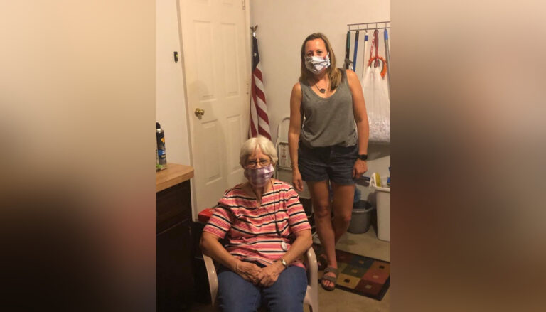 Mother and grown daughter wearing face masks