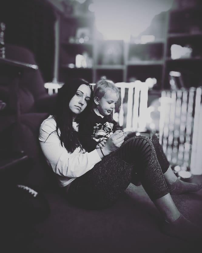 Sad woman sitting with child