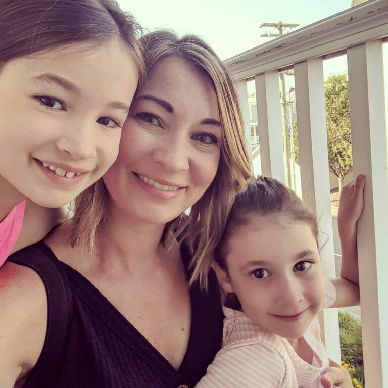 Mother with two daughters selfie, color photo