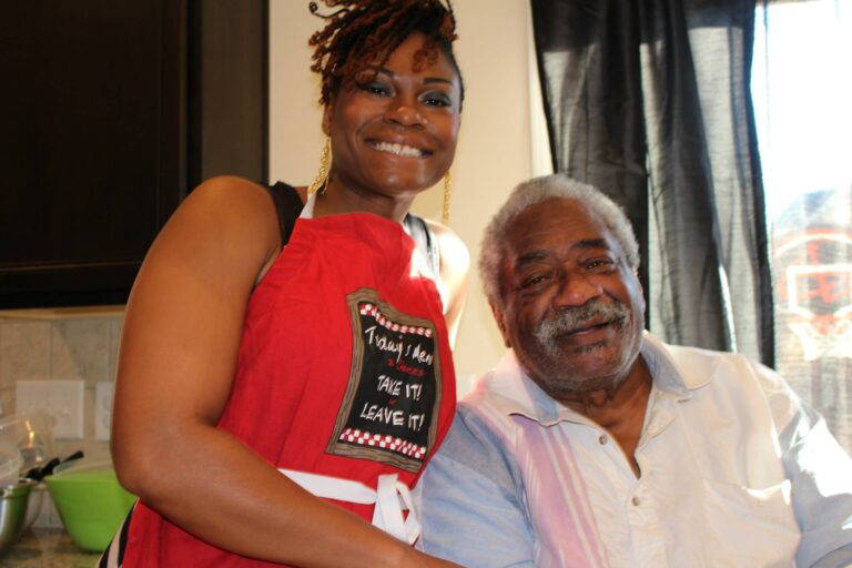 Grown woman with her father, color photo