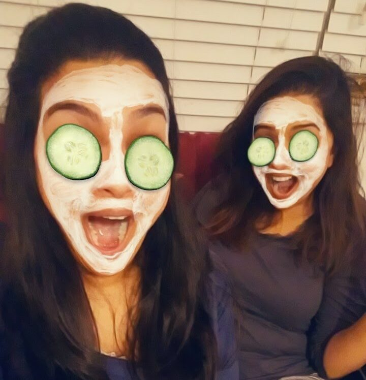 Sisters with facial masks, color photo