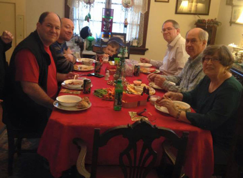Family gathered at holiday table