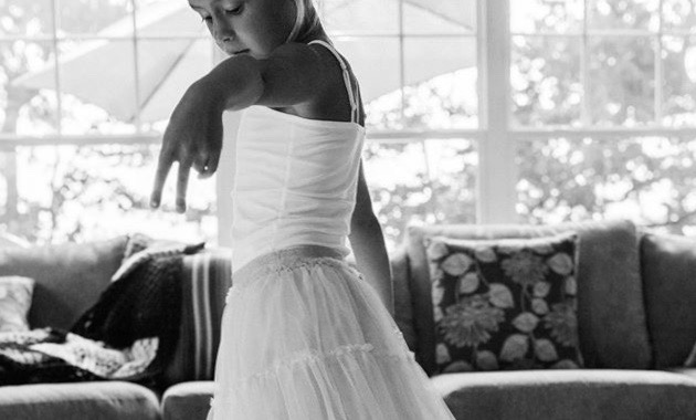 Little girl twirling in dress