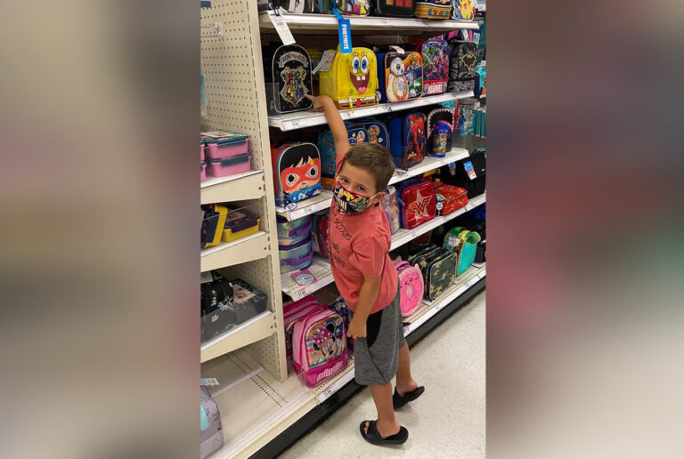 Kindergarten kid picking out lunchbox