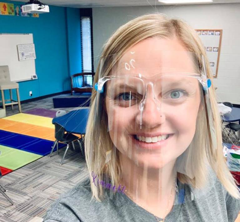 Teacher wearing face shield