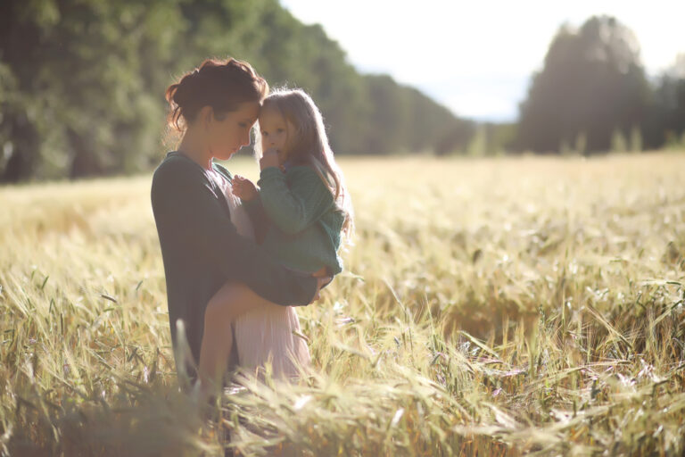Mother and daughter outside in field