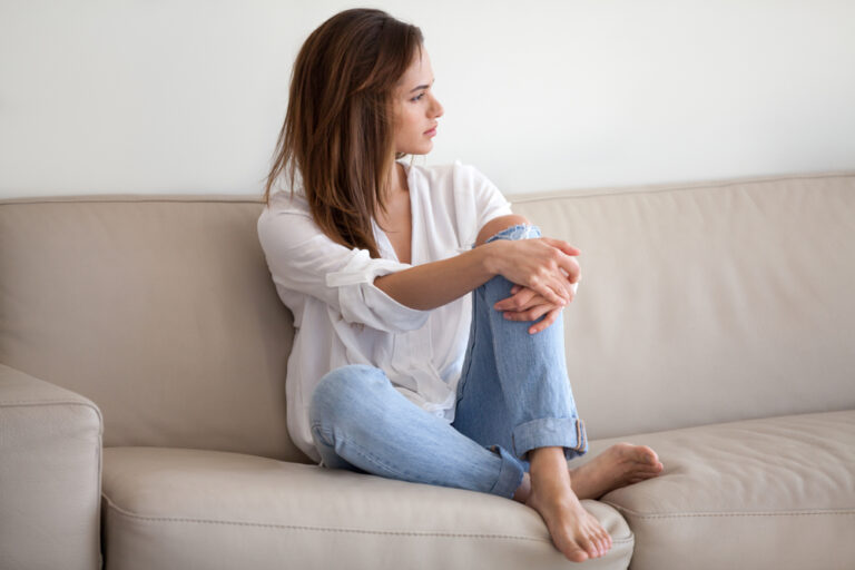 Concerned woman sitting on a couch