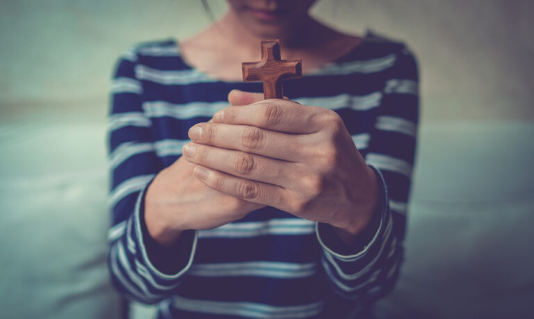 Woman holding cross