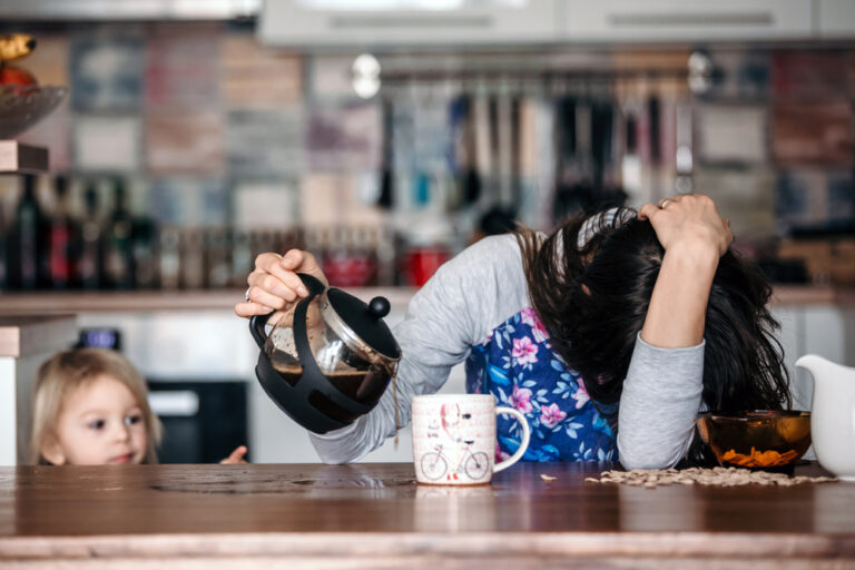 Tired woman pouring coffee