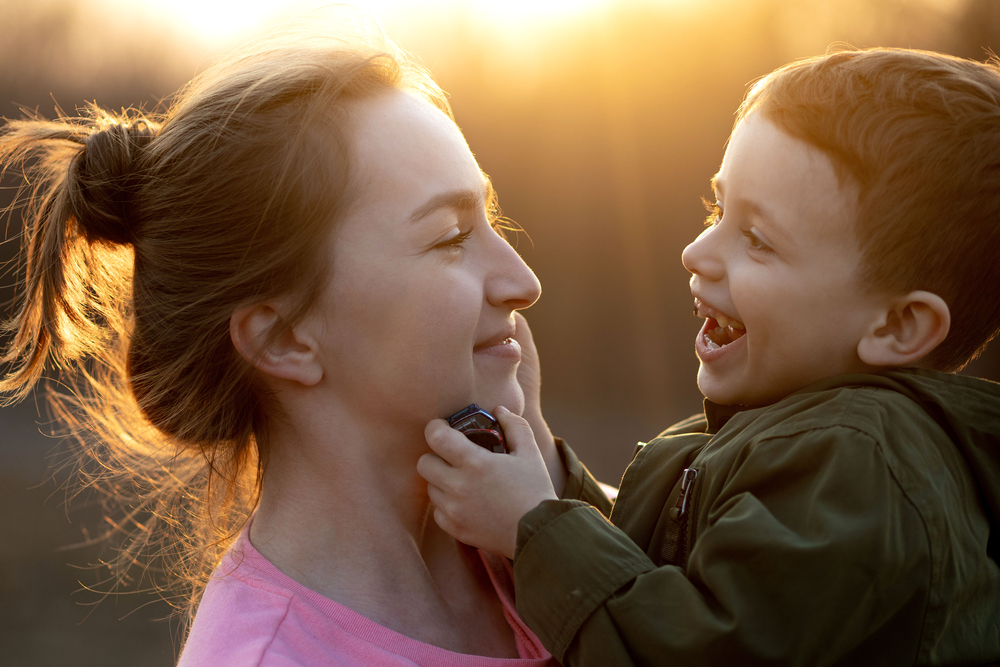 Mom and little boy at sunset