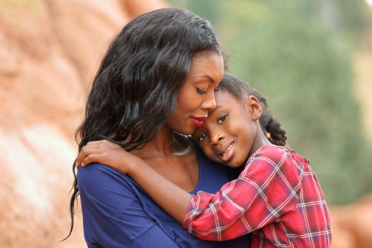 Child hugging mother