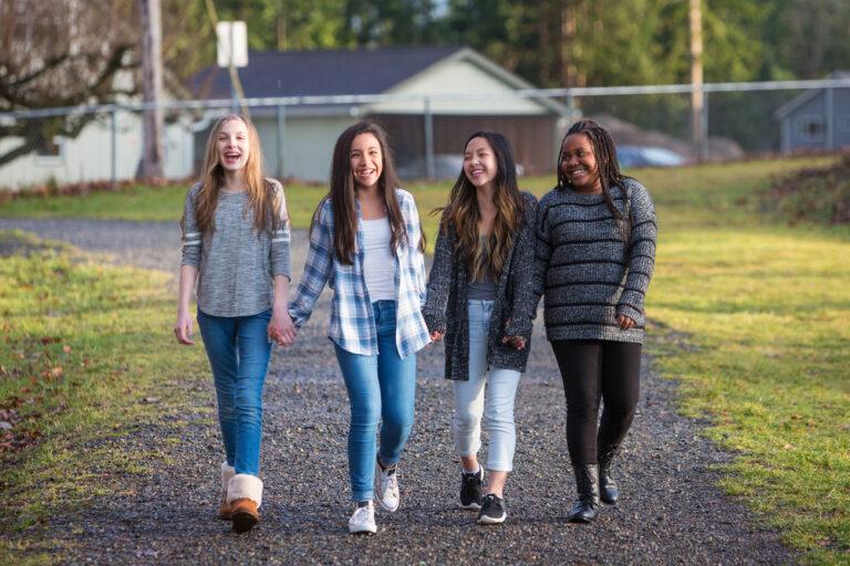 Middle school girls walking