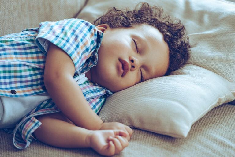 Little boy sleeping on pillow