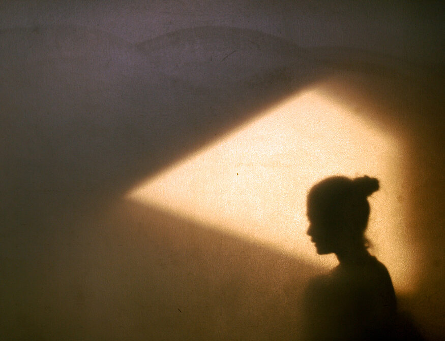 Woman in shadow with light