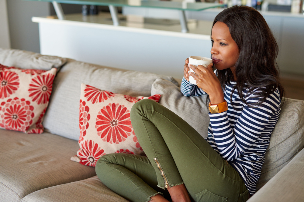 Woman on couch with coffee