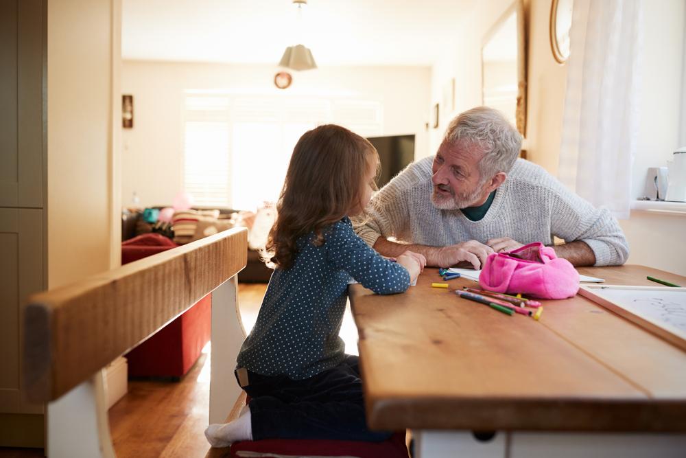 Grandpa with grandchild at table