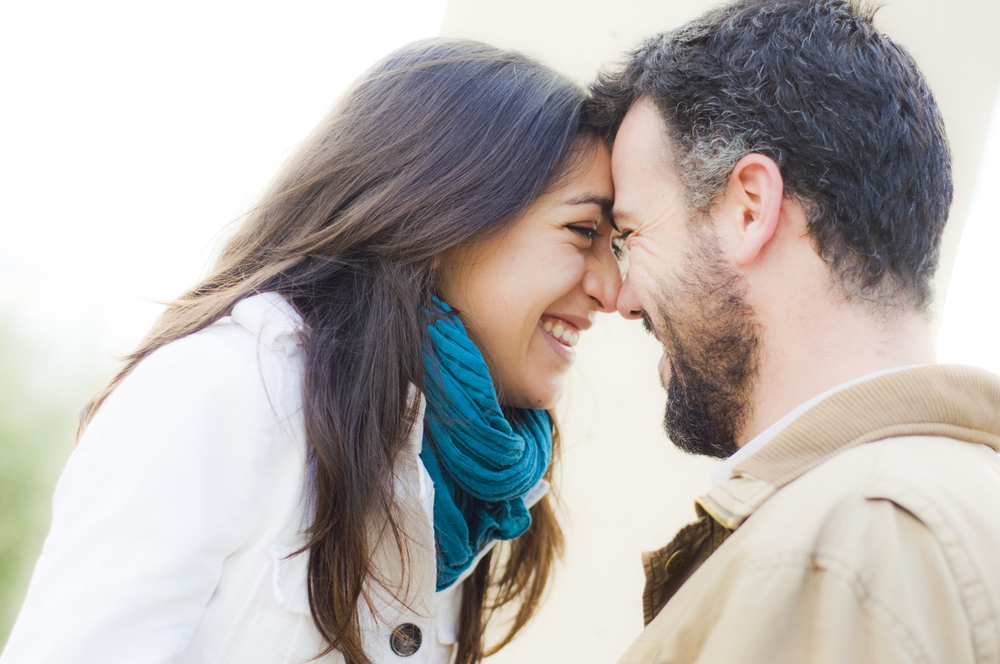 Man and woman smile at each other