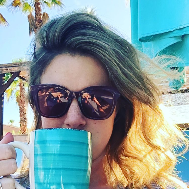 Woman holding coffee mug, color photo