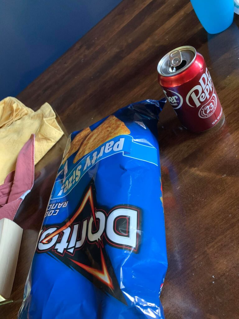 Bag of Doritos and can of Dr. Pepper, color photo