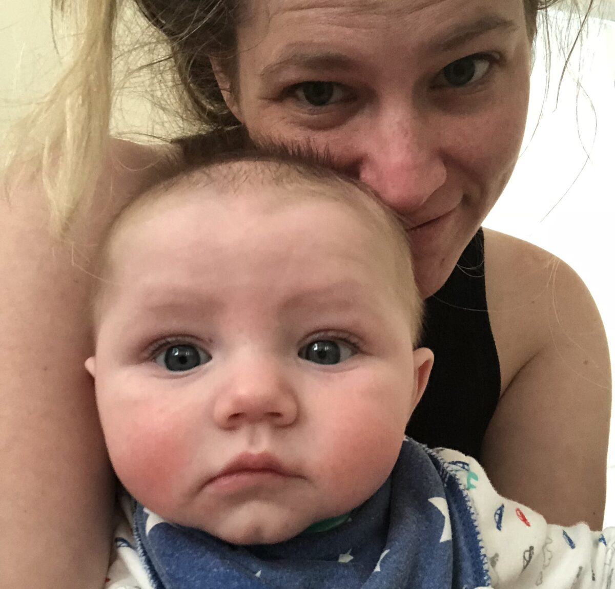 Mother holding baby, selfie, color photo