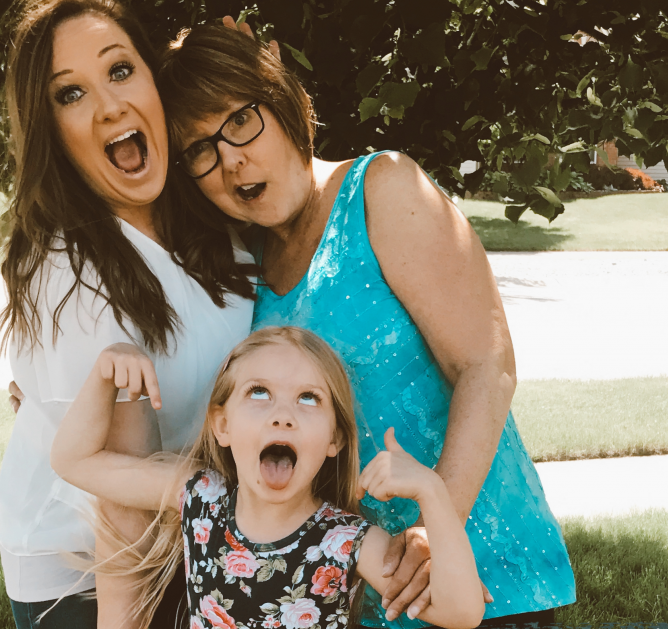 Mom, daughter, and grandma making silly faces, color photo