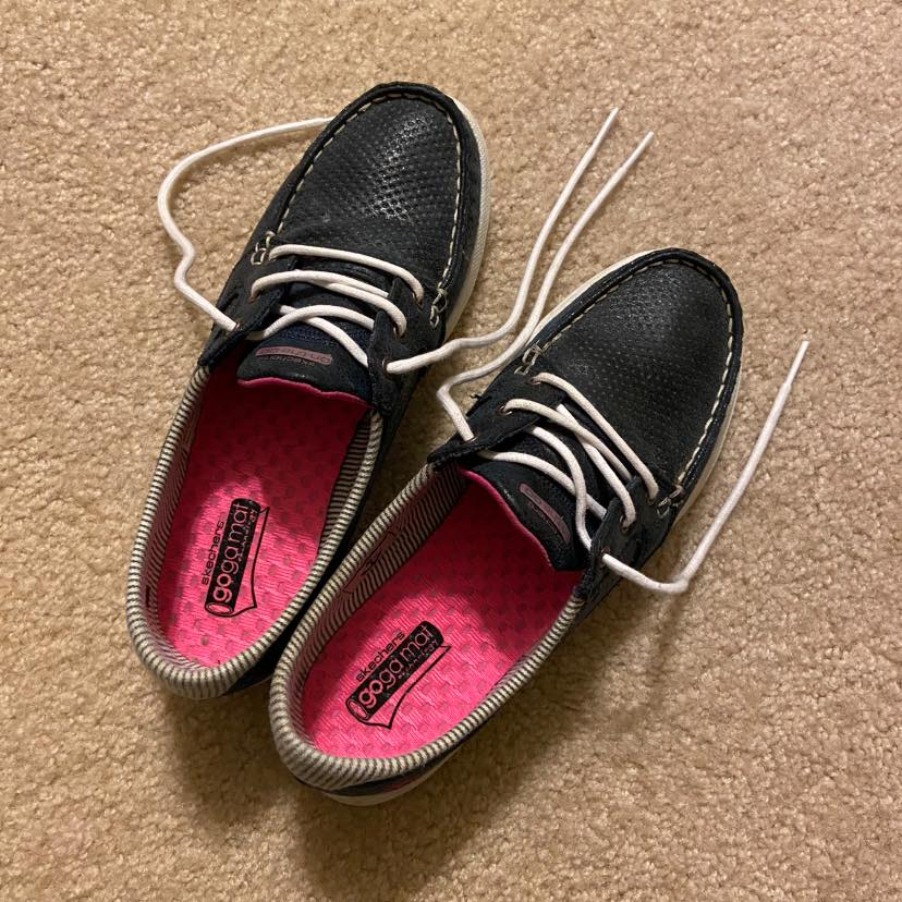 Black shoes with white laces, color photo