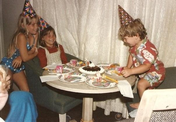 Old photo of children at birthday party, color photo