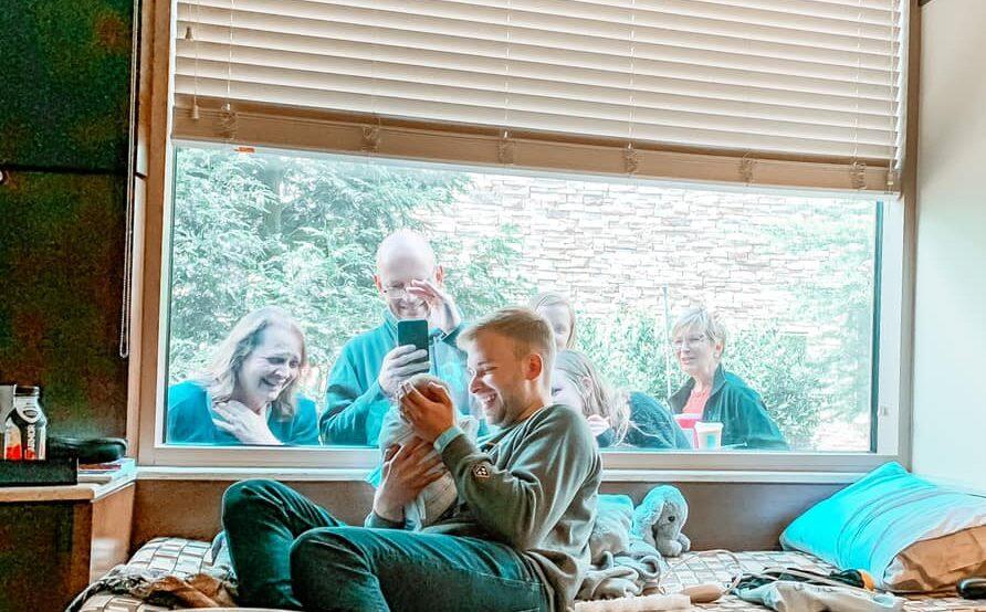 Grandparents meet baby through window