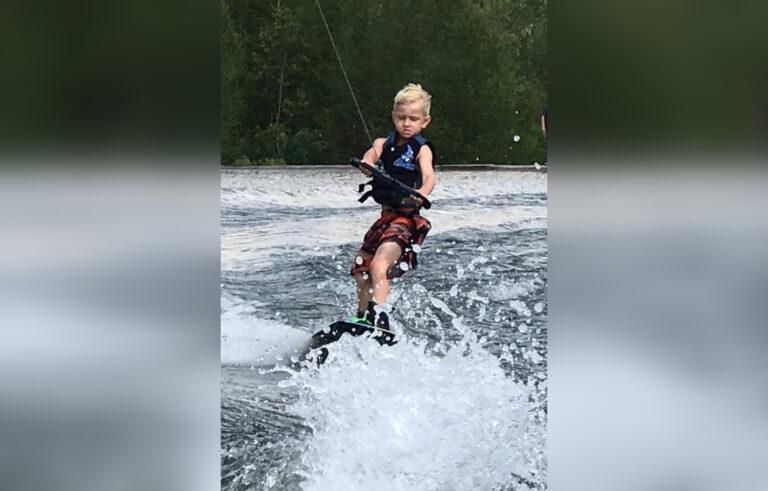 Little boy wakeboarding