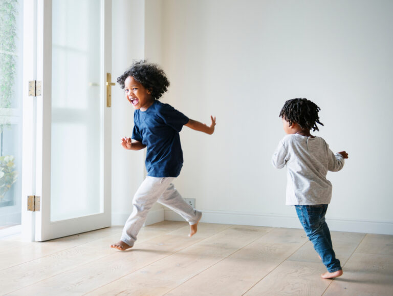 Children running in living room