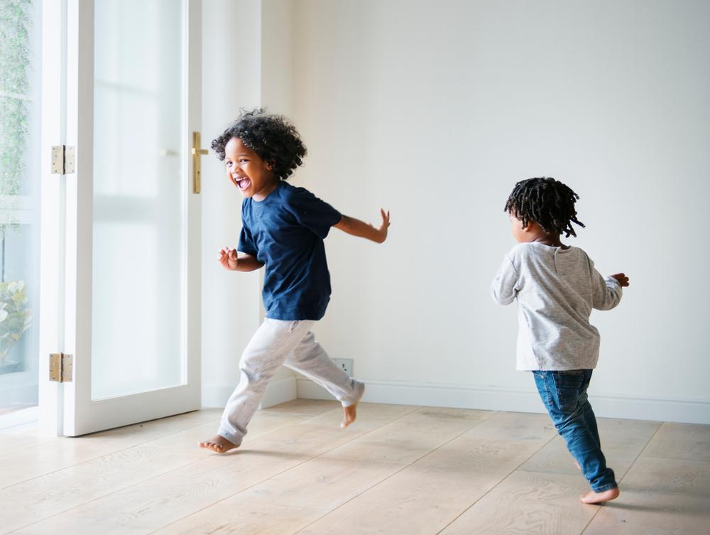 Children running in living room